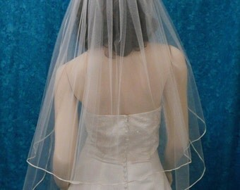 """classic cut bridal veil fingertip length trimmed with 1/8"""" wide satin ribbon trim"""