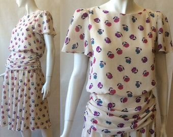 1980's floral print dress in a soft fluttery 1940's style, off white with purple, teal, and fuschia, short sleeve, by Cora's Closet, medium