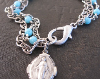 Saints Preserve Us - No. 42 -Miraculous Medal with Pale Blue Stone Beads