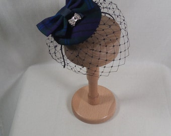 A wee tartan headpiece with bow and veiling