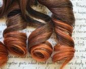 the C H A I . Chai hair extension accent clip in 100% human hair dark brown black auburn orange pumpkin spice
