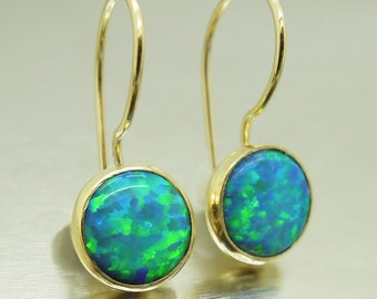 Opal earrings set in gold