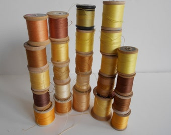 Yellow 24 vintage wood spools of cotton/nylon thread. Star/Belding/Coats and Clarks