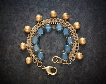 Antique Gold Multi Chain Assemblage Bracelet with London Blue Crystal Coins and Brushed Gold Ball Dangles