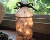 wine bottle lamp,lamps,birch tree,birch tree lamp,cardinals,lighted bottles,wine bottle with lights,lighted wine bottles,wine bottle lamp
