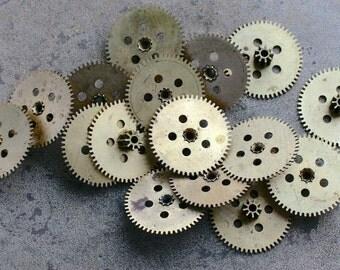 Vintage clock brass gears -- set of 16 -- D15