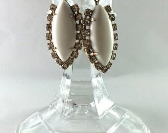 White and rhinestone dangle earrings