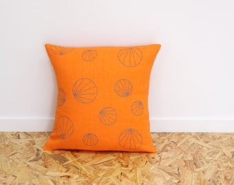 Geometric cushion cover in orange and grey