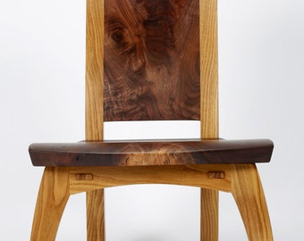 Lounge chair in highly figured walnut and white oak.