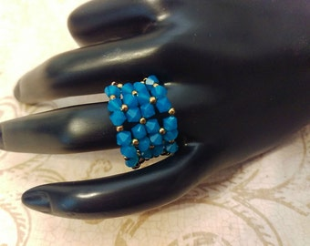 The Peggy- Caribbean Blue Opal AB Swarovski Crystal and Lacey Antique Copper Seed Bead Stretchy Fashion Right Angle Weave Ring
