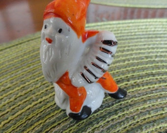 B212)  Vintage Porcelain Elf or Gnome with Squeeze Box Figure marked Japan