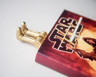 C-3PO bookmark. For fans of Star wars. Unusual art bookmark. legs in book. Robot in the book. Back to school.