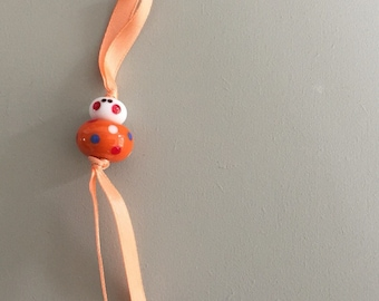 Good luck charm - orange, red, blue and white - free gift pouch