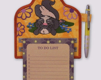 Happy Skunk in Flowers Embroidered Notepad Holder
