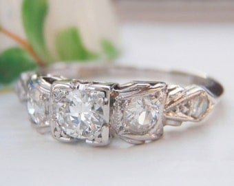 Sweet Art Deco Diamond Engagement Ring. Pretty Bow Styled Setting. Quality Solid Platinum. Plump Old European Diamonds. Vintage bliss!
