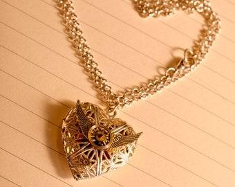 Winged heart locket