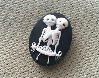 Bright White on Black Conjoined Skeleton Twins Needle Minder