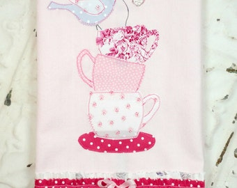 Tea Towel Stacked Tea Cups With A Little Bluebird Holding The Tea Bag On Top Pink Frayed-Ruffled Appliqued Tea Towel