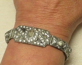 Vintage Art Deco era pot metal crystal rhinestone paste hinged panel bracelet