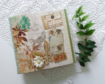 Vintage style spring nature scrapbook, photo album, journal with flowers, birds and butterflies.