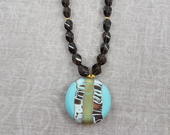 Twisted smoky quartz necklace with polymer clay pendant