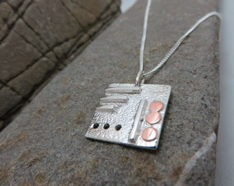 Square sterling silver with copper pendant