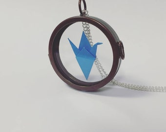 Custom origami crane glass locket necklace.