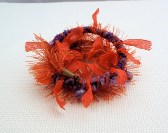 Ribbon, trim, fiber memory  wire wrapped bracelet in oranges and purples