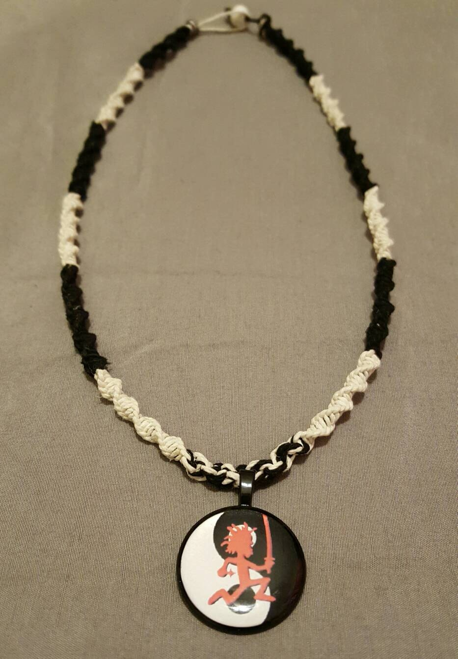 handmade yin yang hatchet sword necklace by