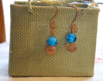 Unique hammered copper dangle earrings with vivid blue glass bead