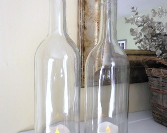 "Clear wine bottle hurricane lantern staggered set with ""bling"" detail on bottom."