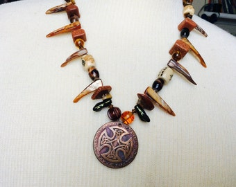 Warrior Princess necklace// RMJ Tactical challenge coin// shell spikes// ceramic beads// goldstone beads// statement necklace//