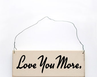 """Wood sign saying """"Love You More"""" Antique white wired sign."""