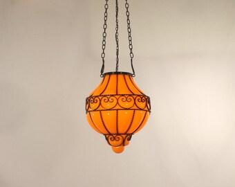 Hand Blown Venetian Orange Glass Blown into Black Wrought Iron Basket Pendant