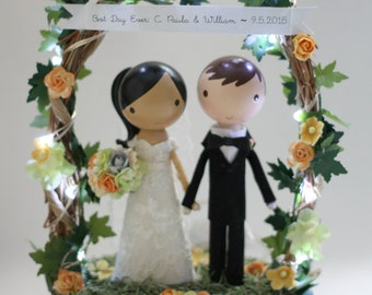 custom wedding cake topper - wood slab, twiggy arch, & twinkle lights