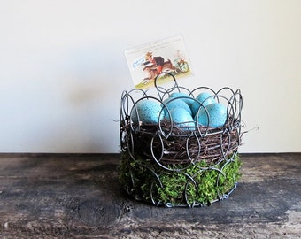 Decorative Easter and Spring Display With a Vintage Wire Egg Basket
