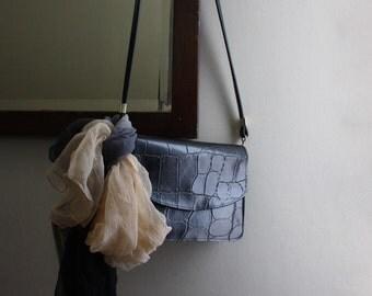 Vintage 1970s cross body black handbag/ foldover clutch. Minimalist