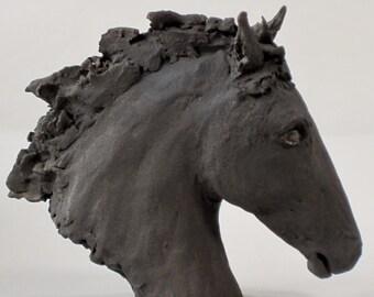 Wild horse head sculpture. Black.