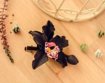 Black orchid flower clip