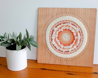 Woven Wall Hanging, Circular Weaving in White and Oranges, 12 inch by 12 inch