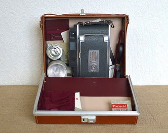 Polaroid 900 Electric Eye Camera and Case, Manuals, Winklight, Flash Attachment, Spare Strap, and Accessories- Collectible Land Camera