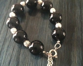 Black beaded bracelet with silver spacers