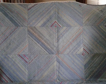 Denim throw with decorative stitches