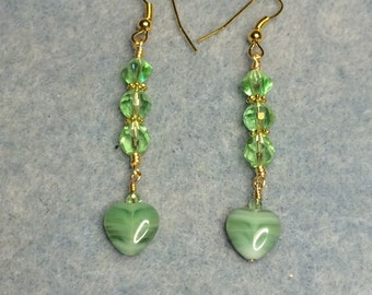 Light green vintage glass heart dangle earrings adorned with light green Czech glass beads.