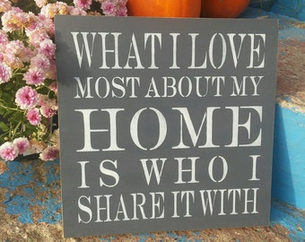 What I love most about my home is who I share it with, stenciled wood sign
