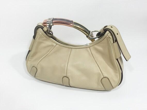 Yves Saint Laurent Mombasa Handbag / by nonaprirequellarmadi