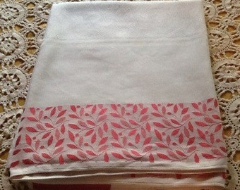 """Red and white, reversible, midcentury, metallic thread, embossed tablecloth 54.5""""x 70"""""""