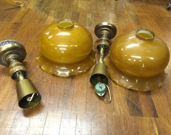Two 1970's mustard glass lights, one standard ine pull down