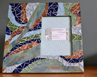 green,blue, and copper picture frame