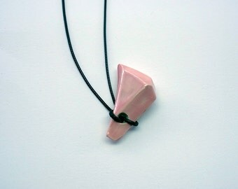 Long necklace with a crystalshaped ceramic pendant, light pink glazed with a mother of pearl luster
